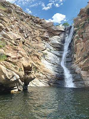 Cedar Creek Falls is a five-mile roundtrip hike from the Ramona trailhead and requires a permit for visitation.