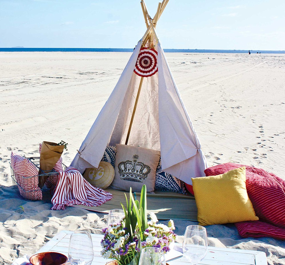Coronado's Heather Nunnelly set up a company to bring you everything you need for an indulgent beach afternoon: tipi, carpets, table, cushions, a charcuterie plate to snack on.