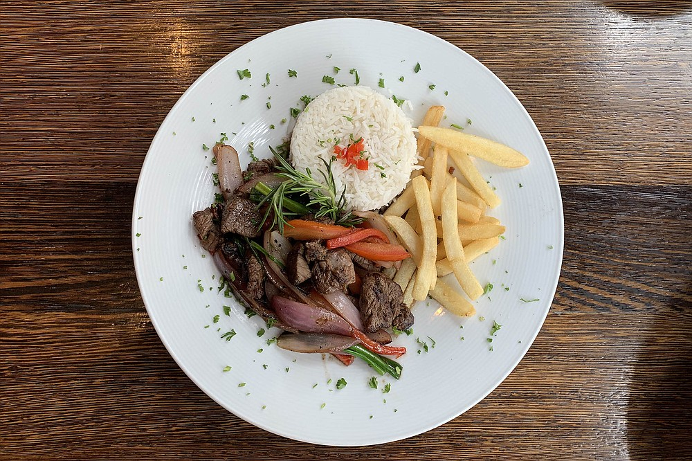 Lomo soltado, served with rice and fries