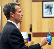 Prosecutor Cal Logan showed the knife to the jury, during trial.