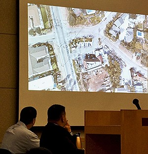 The fatal collision happened at a Y shaped intersection in Vista California. Palafax looks at evidence displayed for jury.