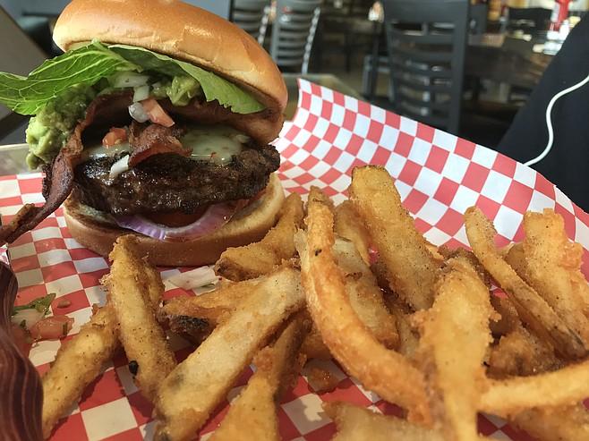 Erick's Guaca Burger and fries