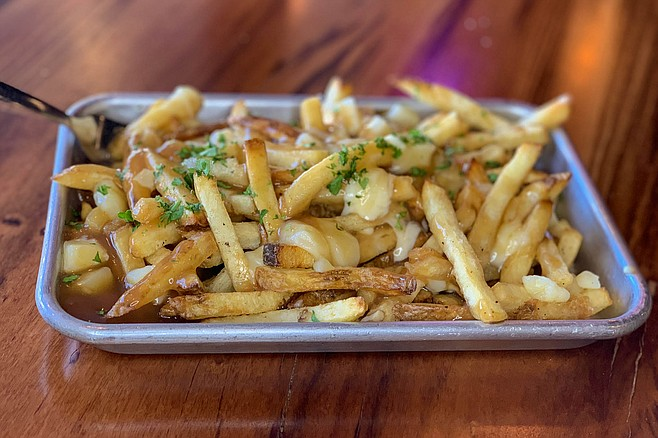 Brown gravy and cheese curds make these fries French-Canadian.