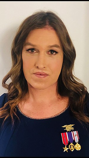 Kristin Beck, complete with SEAL insignia and medals