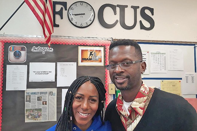 "Johnson, with wife and fellow teacher Roushaun, says, ""Sadly, [how to be a man] is not always taught at home."""