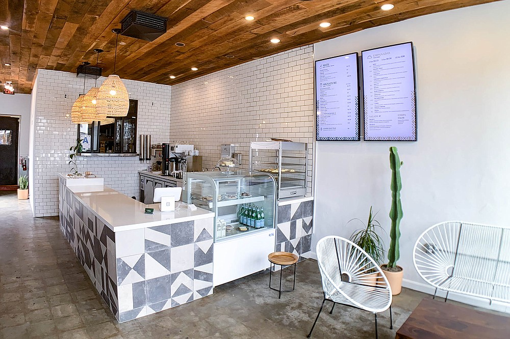 A simple, stylish counter shop serving empanadas and a litany of yerba drinks .