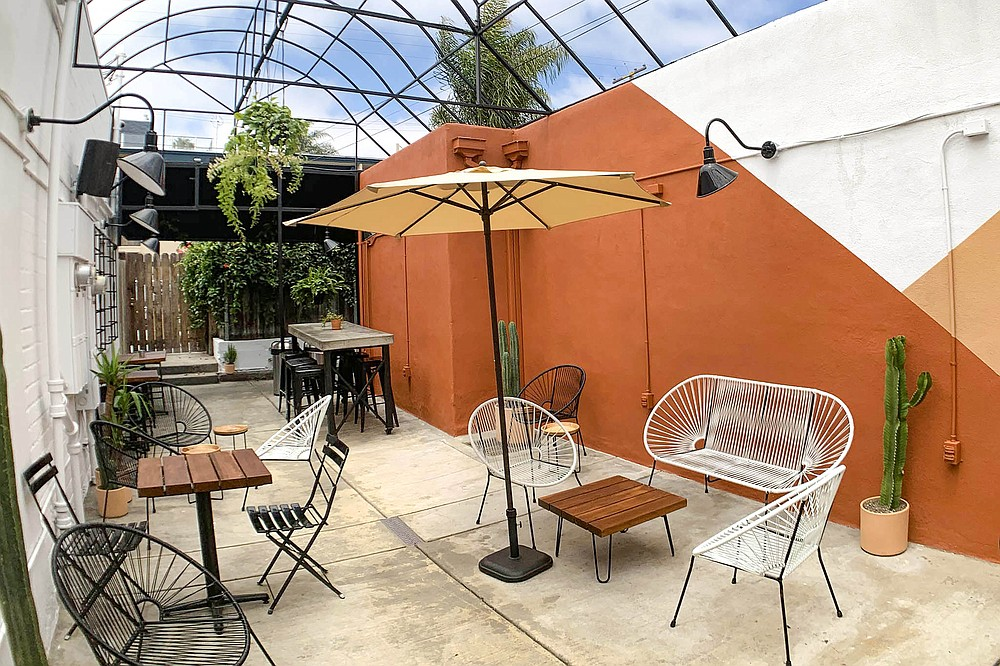 The back patio at Yerba Mate Bar lets customers sit outside, away from the street life on Garnet Avenue.
