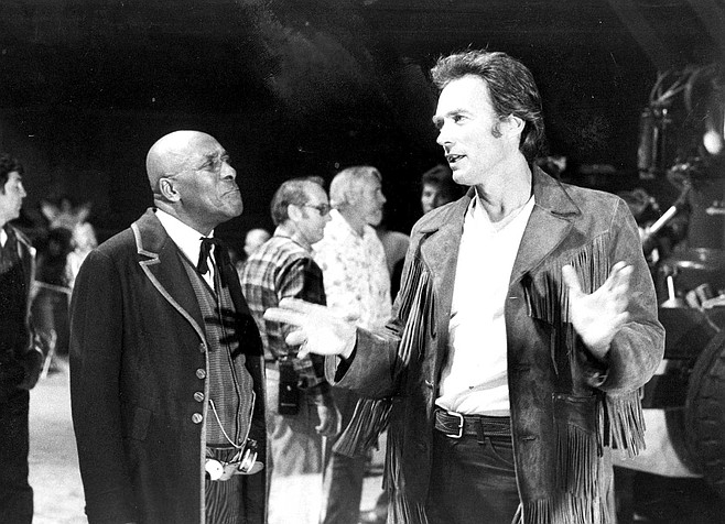 Scatman Crothers and Clint Eastwood between takes on Bronco Billy.