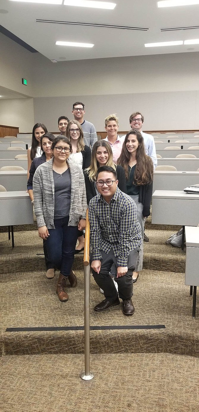 California Western School of Law's Community Law Project student-interns pose before heading out to help immigrant tenants and landlords pro bono. Cameron Bell top right (with glasses) and Shyam Patel is two in from top left.