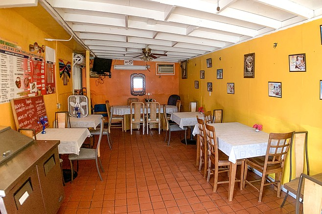 Casual Rincon Azteca dining room, with mismatched dining furniture and pretty tablecloths