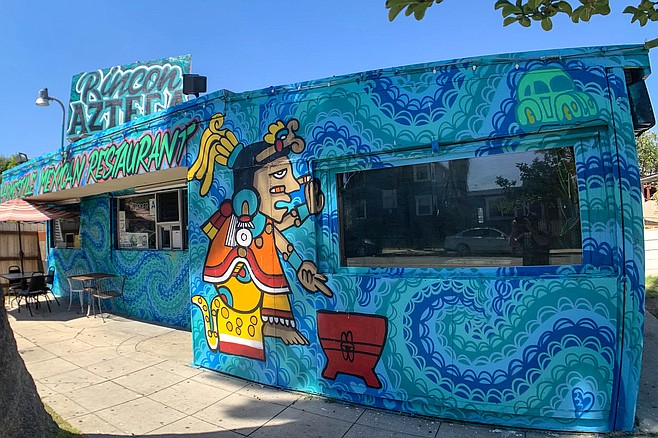 A blue and green mural announce the name change from Mama's Kitchen to Rincon Azteca.