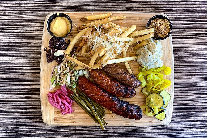 A chef's board of house-made game sausage