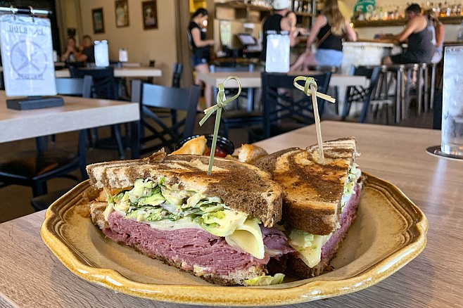 A reuben with house-cured corned beef and Brussels sprout slaw