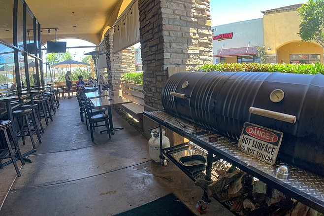 A smoker on a dining patio in East County