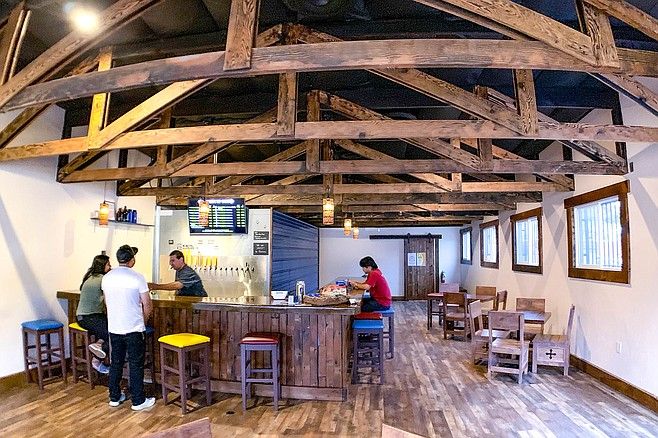 Century old wood and Mission styling create a beer space in Vista.