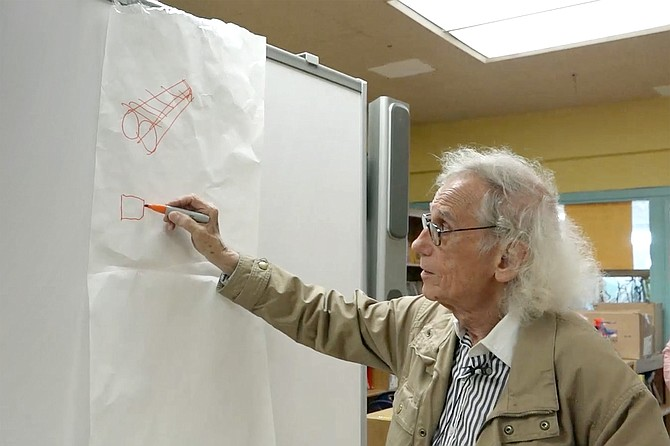 Walking on Water: Super-scale artist Christo demonstrates his vision to a group of schoolchildren.