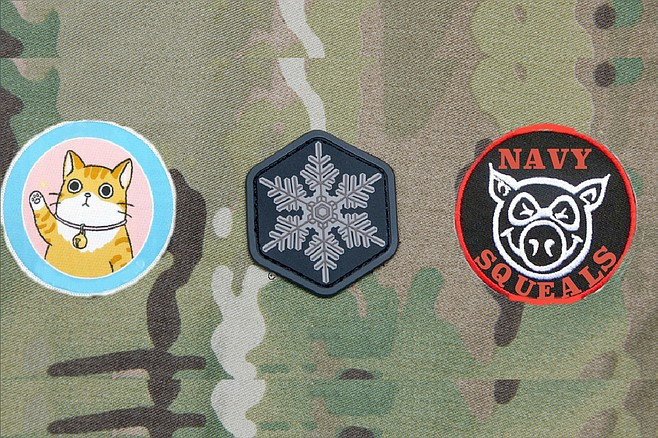 "From left to right: The ""Bunch of Pussies"" patch, so called because, according to a letter provided to the Navy Times, Gallagher responded to criticism that it was extremely unnecessary to train troops by placing them in daytime live-fire situations by saying that his junior SEALs — several of whom testified against Gallagher — were ""all a bunch of pussies"" who needed the kind of engagement where ""you need to focus on your field of fire or else you could take (a bullet) to the side of the head."" (The pussy in question notably wears a bell around its neck, much like the cat in the Aesop's Fable, which serves to warn of its approach. This is taken as a reference to Gallagher's decision to, as prosecutors put it, ""spread rumors about his teammates to members of the SEAL community, describing them as cowards who were afraid to go out on missions,"" even going so far as to ""tell the new chain of command for teammates who had transferred."" Gallagher's attorney did not deny the accusation, but preferred to call it ""telling the truth."") Second is the Snowflake patch, with its obvious designation of the young SEALs as members of the overly-emotional, easily offended, conflict-averse Generation Snowflake. (""This all started because these kiddies thought I was stealing from their care packages, and they get grumpy when they don't get their afternoon milk and cookies,"" Gallagher has been reported as saying. ""So they ganged up and formed the military equivalent of an online mob and tried to cancel me. But the Navy isn't Twitter, thank God."") Finally, the Navy SQUEALs patch, wherein SQUEAL stands for Sissified Quisling Unable to Endure Actual Leadership. Because, as Gallagher's attorneys put it, ""Those little piggies tried to go wee, wee, wee all the way home, but the Big Bad Wolf was too smart for them."" A fourth patch, depicting a bulls-eye target and intended to be worn on the helmet, was considered but ultimately rejected. After all, said Gallagher, ""We're a brotherhood."""