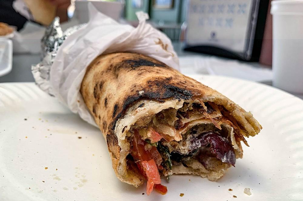Fried eggplant, lebni, mint, olives, and more dress up the ultimate manaeesh supreme.