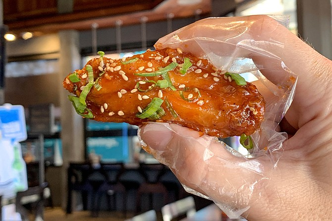 Finger naps to keep 'em clean while eating glazed fried chicken wings
