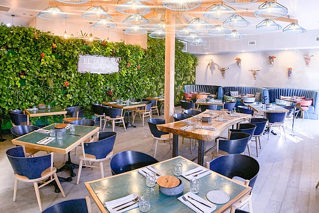 Most of El Jardin's tables are outdoors, but the dining room is colorful and creative.