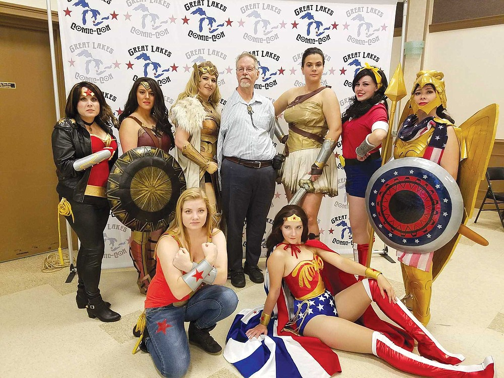 Bill Messner-Loebs (center) with Wonder Woman cosplayers at the Great Lakes Comic-Con.