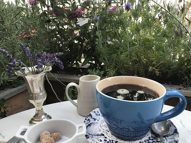 Nice big French cups keep $3 coffee steaming in an herbal garden
