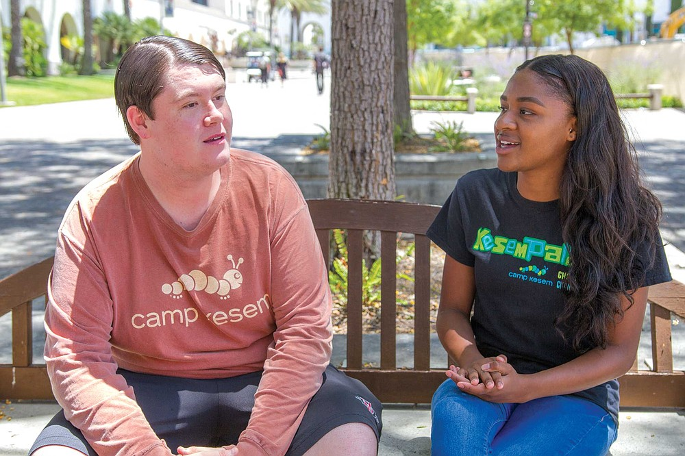 Tyler Leptich and Jada Claiborne are counselors at Camp Kesem, a camp for children of cancer patients.