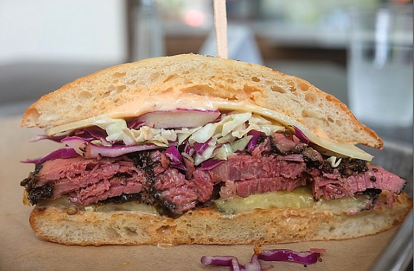 A Reuben-like sandwich with a house pastrami of hickory-smoked brisket, served on a ciabatta
