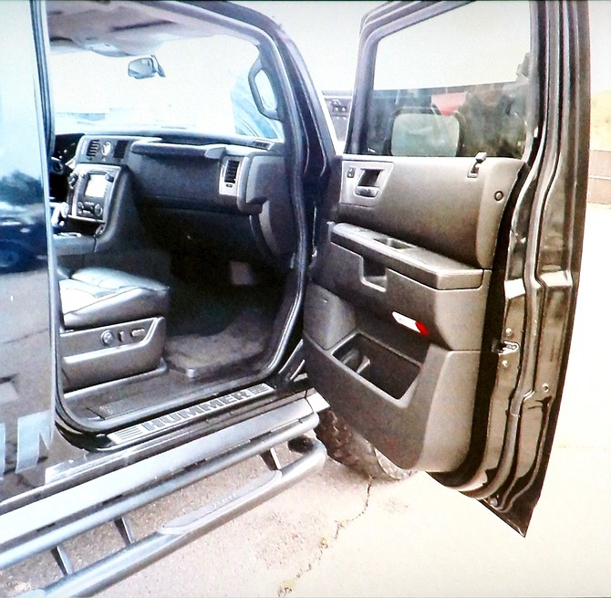 Evidence photo shows passenger side of Hummer, where rapes allegedly occurred.