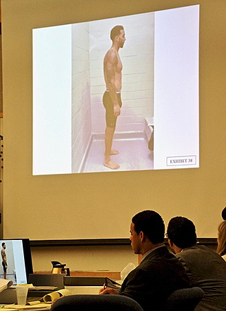 Kellen Winslow Jr looks up at one of the arrest photos of himself, displayed for the jury.