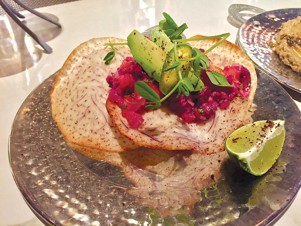 Standout appetizers at Cafe 21 include the vivid beet-cured salmon ceviche served on crisp taro chips