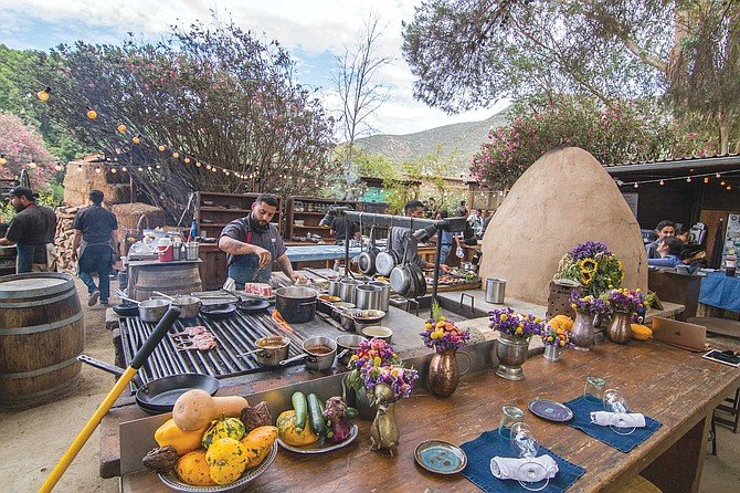 Enjoy the aromas wafting from the wood-fire, outdoor kitchen at Deckman's en el Mogor