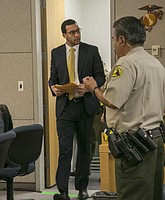 Defendant Winslow greets his father each time he enters the room. Photo by John Gibbins.