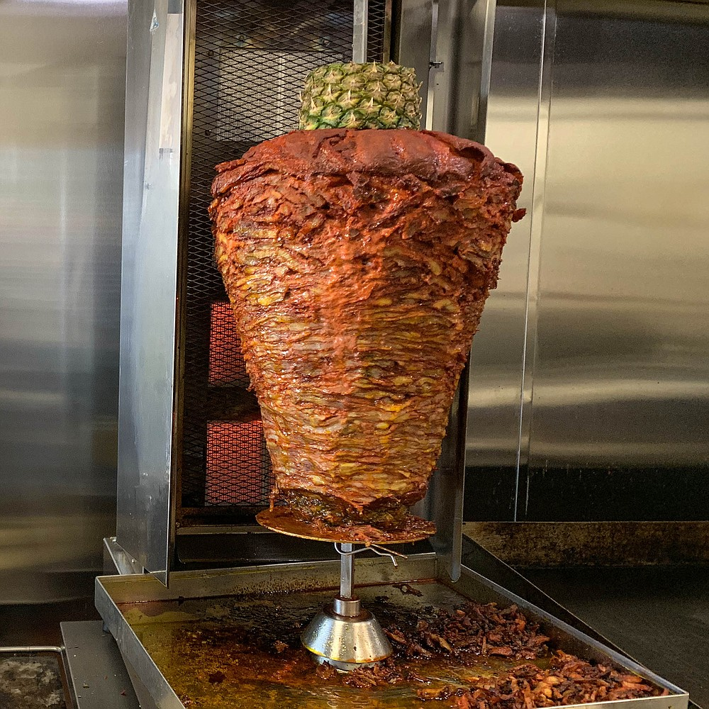 The trompo at the center of Tacos El Trompo