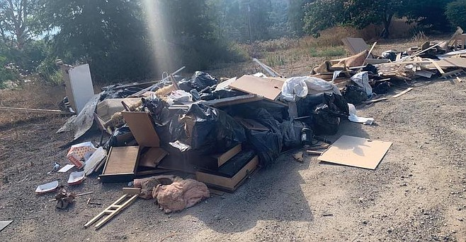 On August 8, somebody drove back to the property and picked up the bathroom remodel debris.