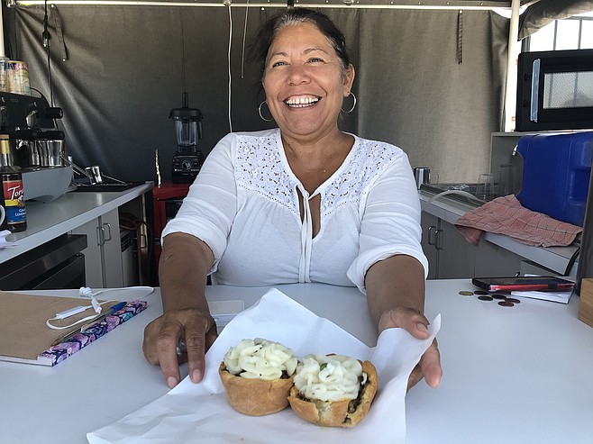 Maria Lopez with the week's last two Oxford-style meat pies