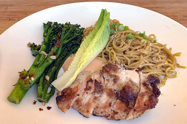 Roasted free range chicken breast with sesame noodles and broccolini