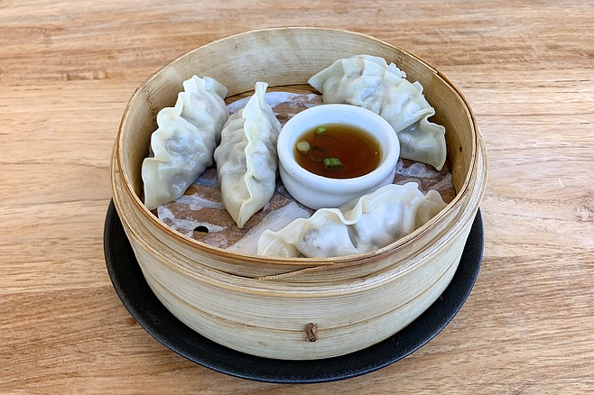 Steamed mandu dumplings, filled with beef, carrot, and onion meatballs