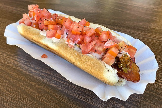 Specialty dog The 'O'. with jalapeño relish, Russian dressing, diced tomatoes, and a strip of bacon