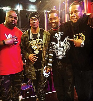 Nick Cannon, host of the VH1 show Wild 'N Out (second from left), with Jason Crawford (second from right). According to students, Crawford would often talk about his connection to Cannon.