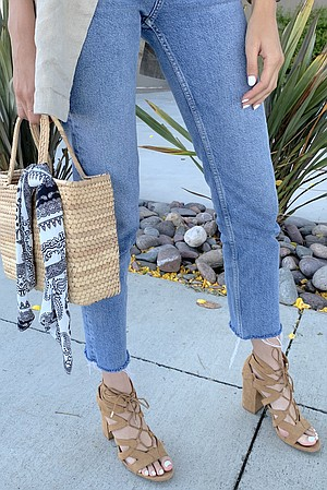 Straw bags like Melissa's are trending this summer