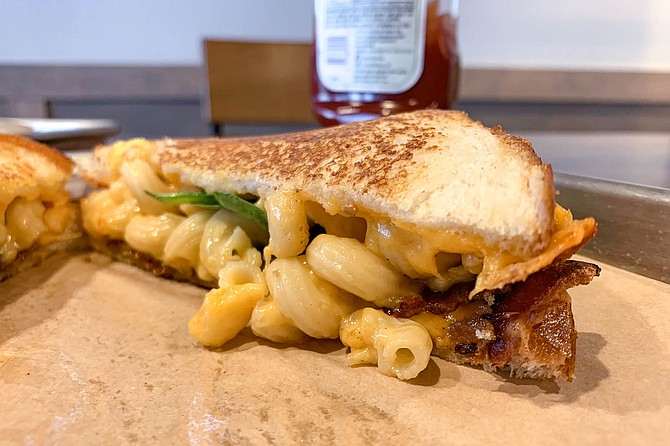 Macaroni , bacon,and too little spinach on a grilled cheese sandwich