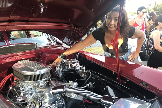 Marisa Rosales points to her outsize carburetor