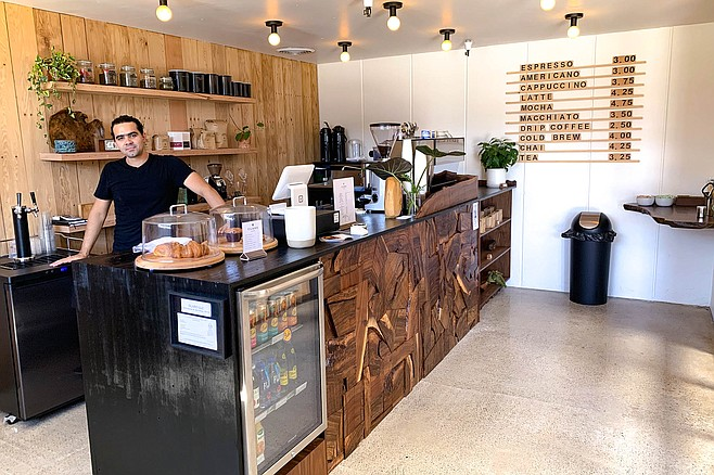 Jorge Diaz serving coffee at his new coffee bar, Claro Coffee