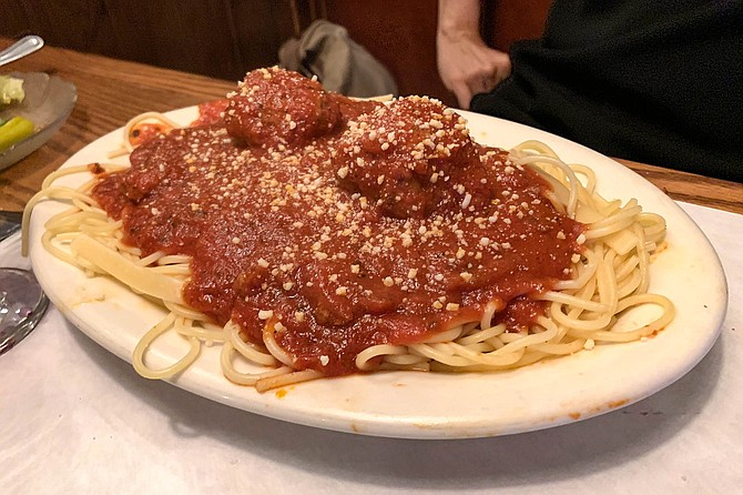 A seminal example of spaghetti and meatballs, mid-century U.S.