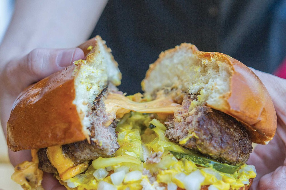 The Juicy Lucy at Del's Hideout is stuffed with American cheese so it explodes like a cheese grenade when you bite it, which is weirdly better than cheese melted on top.