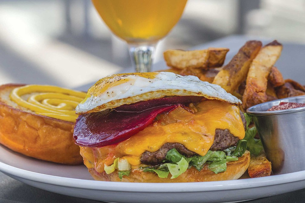 The Kairoa Kiwi burger is topped with housemade tomato chutney and marinated beets — rather than ketchup and a pickle — and a fried egg.