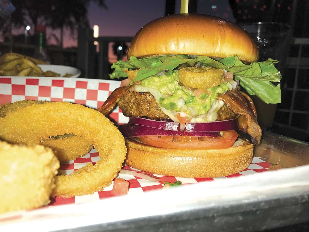 The Guaca Burger at Maggie's Cafe piled high with, of course, a ton of guacamole, as well as pepper jack cheese, bacon, and breaded jalapeños to give a nice jolt of heat.