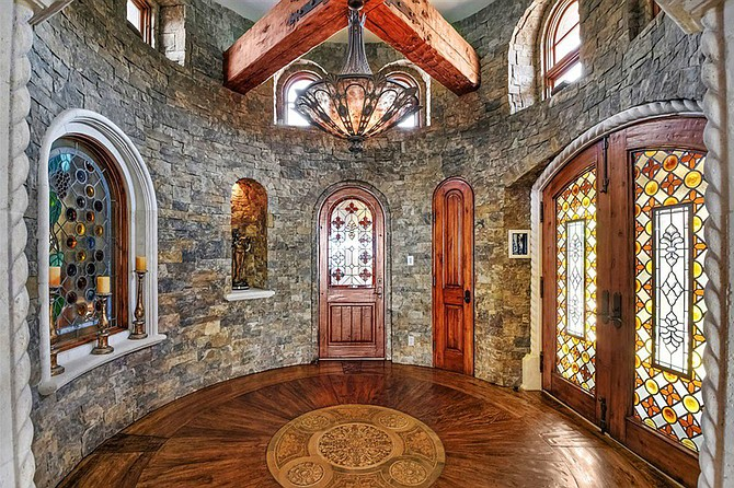 Really, is it even worth having an entry rotunda if you're not going to line it with stone?