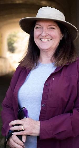 Denise Harter inside animal tunnel